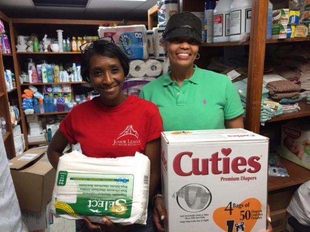 JLBR President Kathy Victorian with JLBR member Quanda Charles delivering diapers to the Jewel J. Newman Community Center.