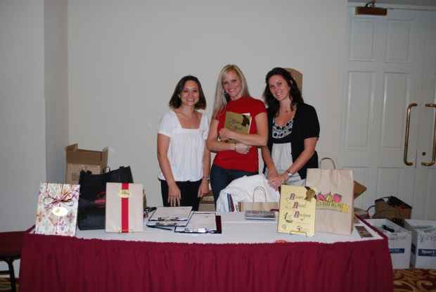 Ladies of the 2009-2010 RRR Committee showing up the special 50th Anniversary limited edition of River Road Recipes I.